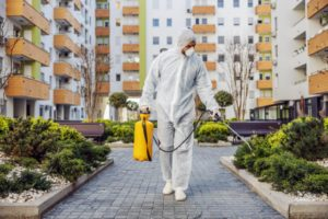 cleaning-disinfection-outside-around-buildings-covid-19-epidemic-sessional-teams-disinfection-efforts-infection-prevention-control-epidemic-e-suit-mask-min