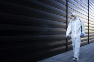 person-white-chemical-protection-suit-doing-disinfection-pest-control-spraying-poison-kill-insects-rodents-min