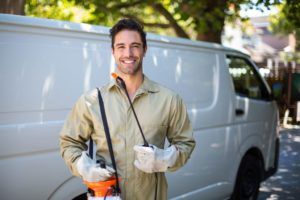 smiling-worker-with-pesticide-sprayer-min